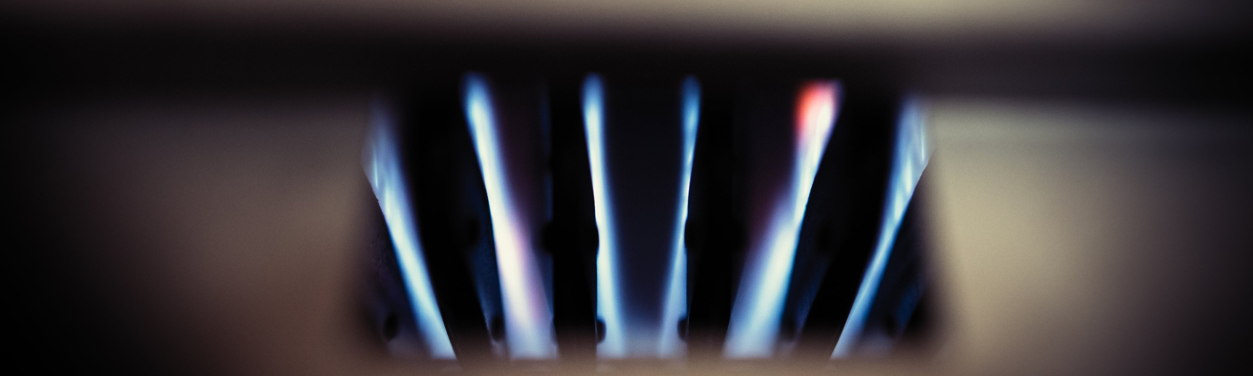 Blue flames from a gas boiler.