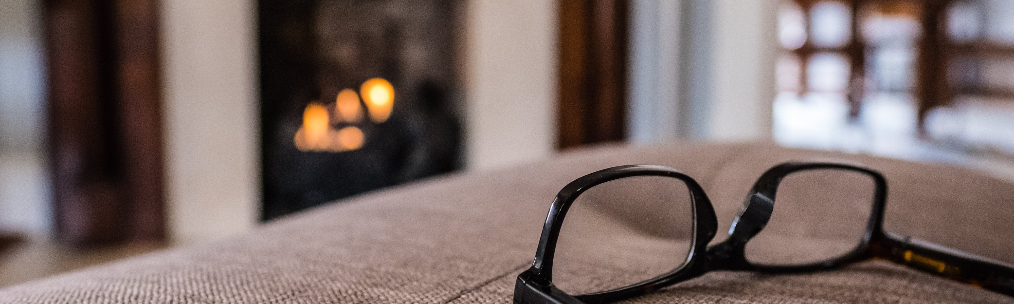 Gas fireplace with glasses in the foreground.